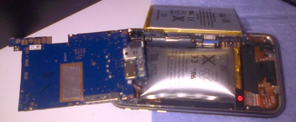 The thin silver block at the top is a new iPhone battery. The silver bag at the bottom is the exploding one