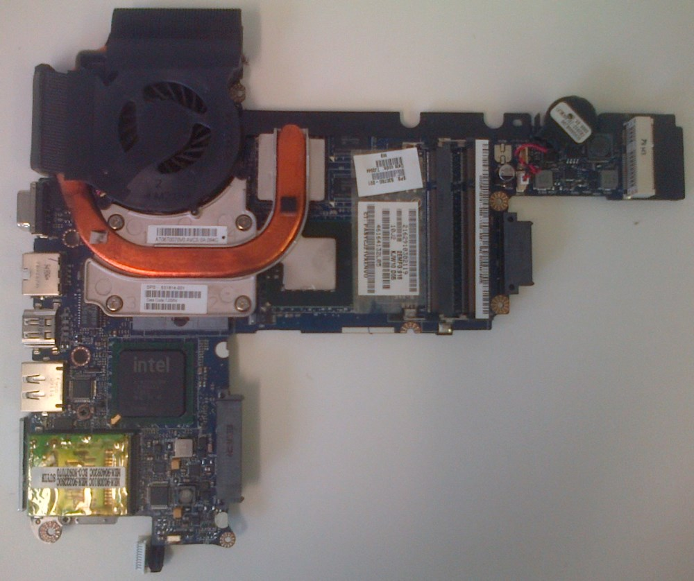 Motherboard removed from chassis - view from bottom with heat sink and fan in place.